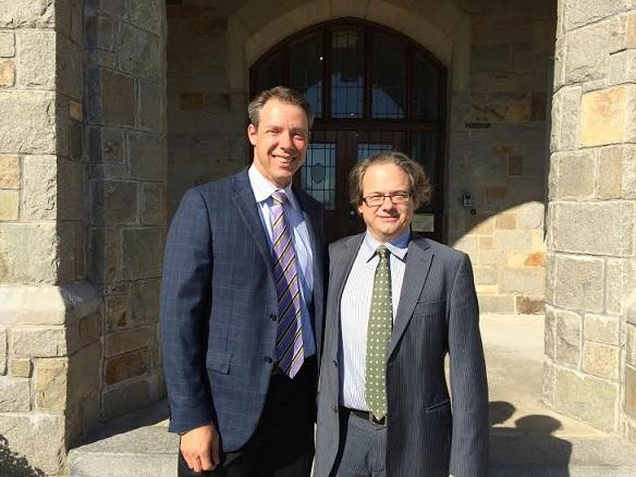 MMI Holdings Chris DeMarino and Head of School Steve Griffin pose in front of the school steps. The two are collaborating on future plans for MacDuffie. Photo taken by Alana Ford.