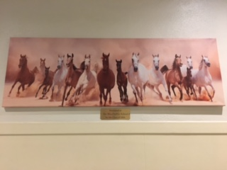 The mysterious Mustang painting decorating the front hall has no discernible origin.