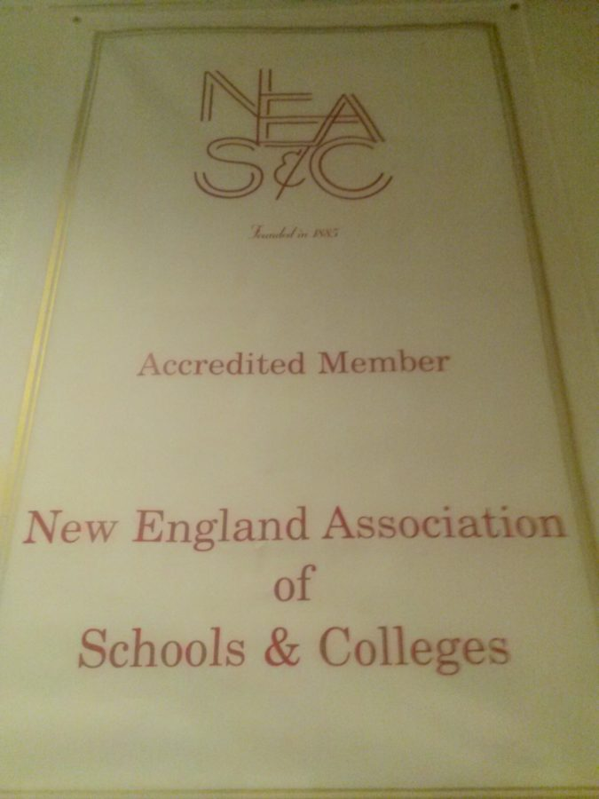 A+front+hall+banner+displays+MacDuffie%27s+NEASC+accreditation%2C+which+is+in+the+process+of+being+renewed.
