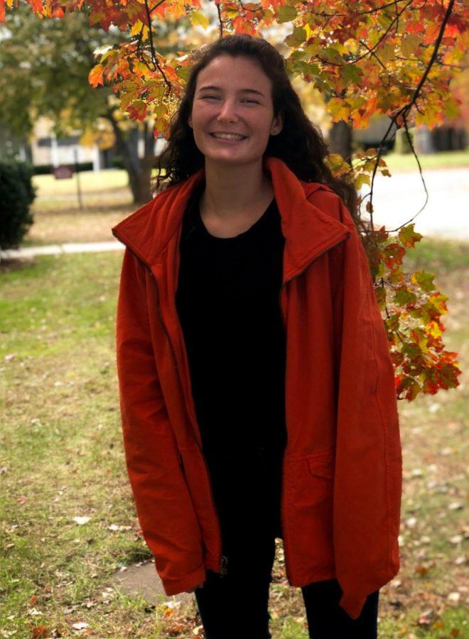 Senior Sophie Sharp wears her orange raincoat to support Anti-Bullying month at MacDuffie.