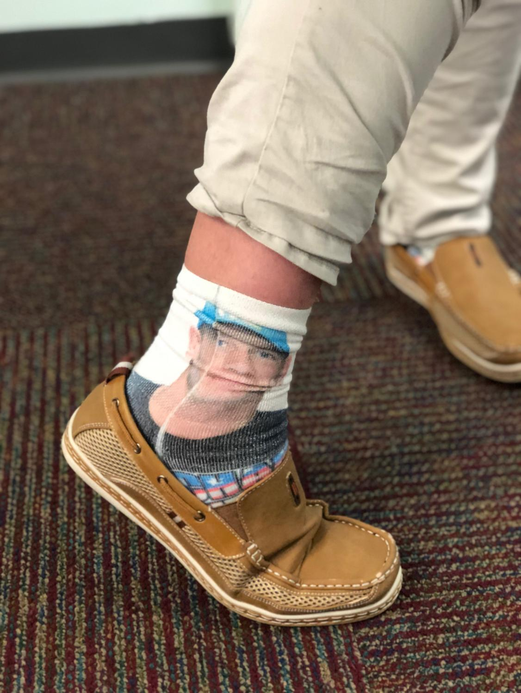 Sock-tober contest winner, Sophomore Jackson Skibel shows off his John Cena socks.