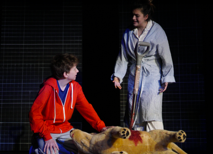 Christopher, played by 8th grade student, Gabe Shumway, and Mrs.Shears, played by junior, Martina Lopez, mourn the death of Wellington, the dog.