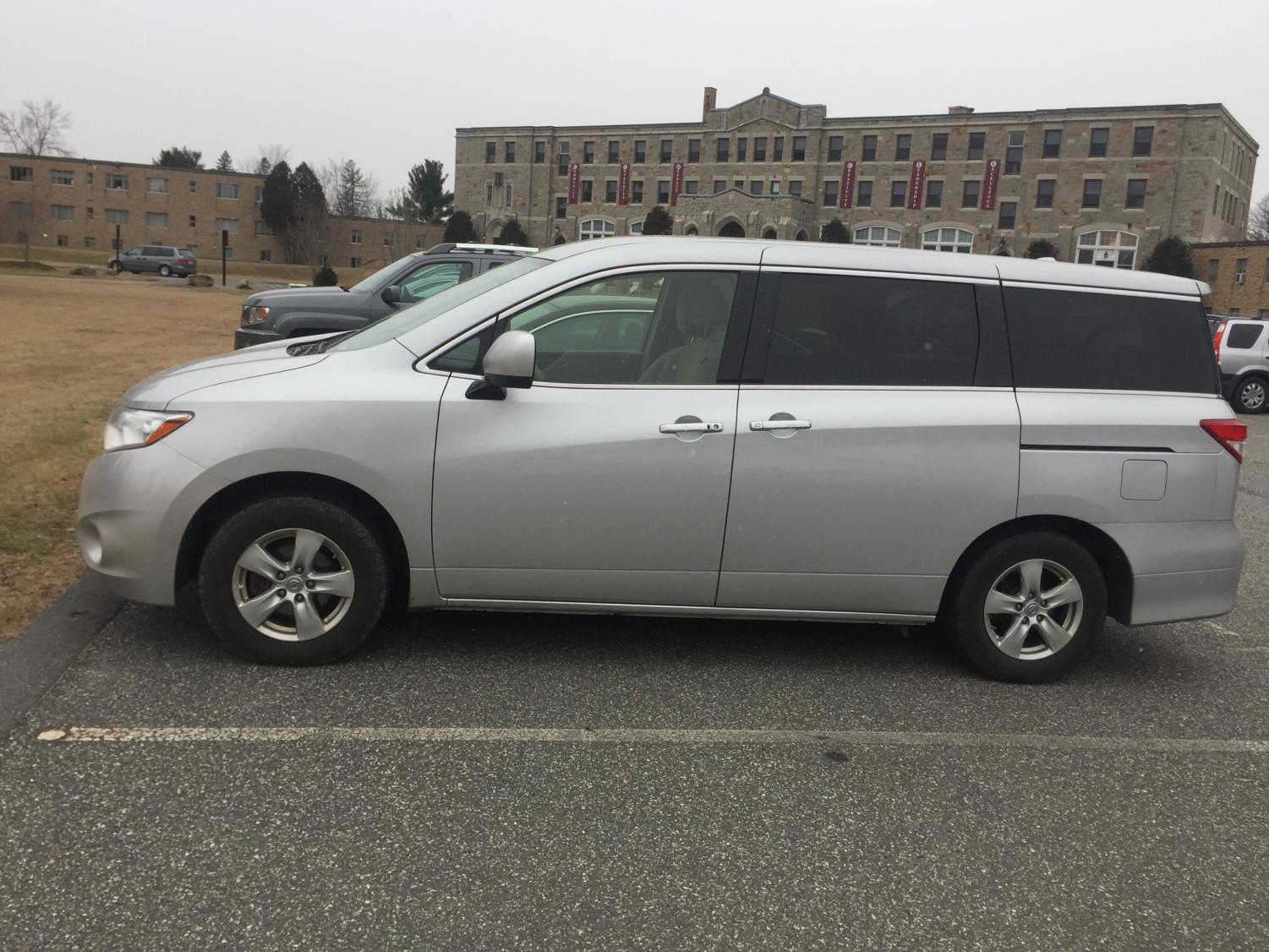 A MacDuffie minivan sitting outside the school's main building in the parking lot. This is the same model of the minivan that caught on fire; however there are some changes such as the color. Photo by Marie Hua