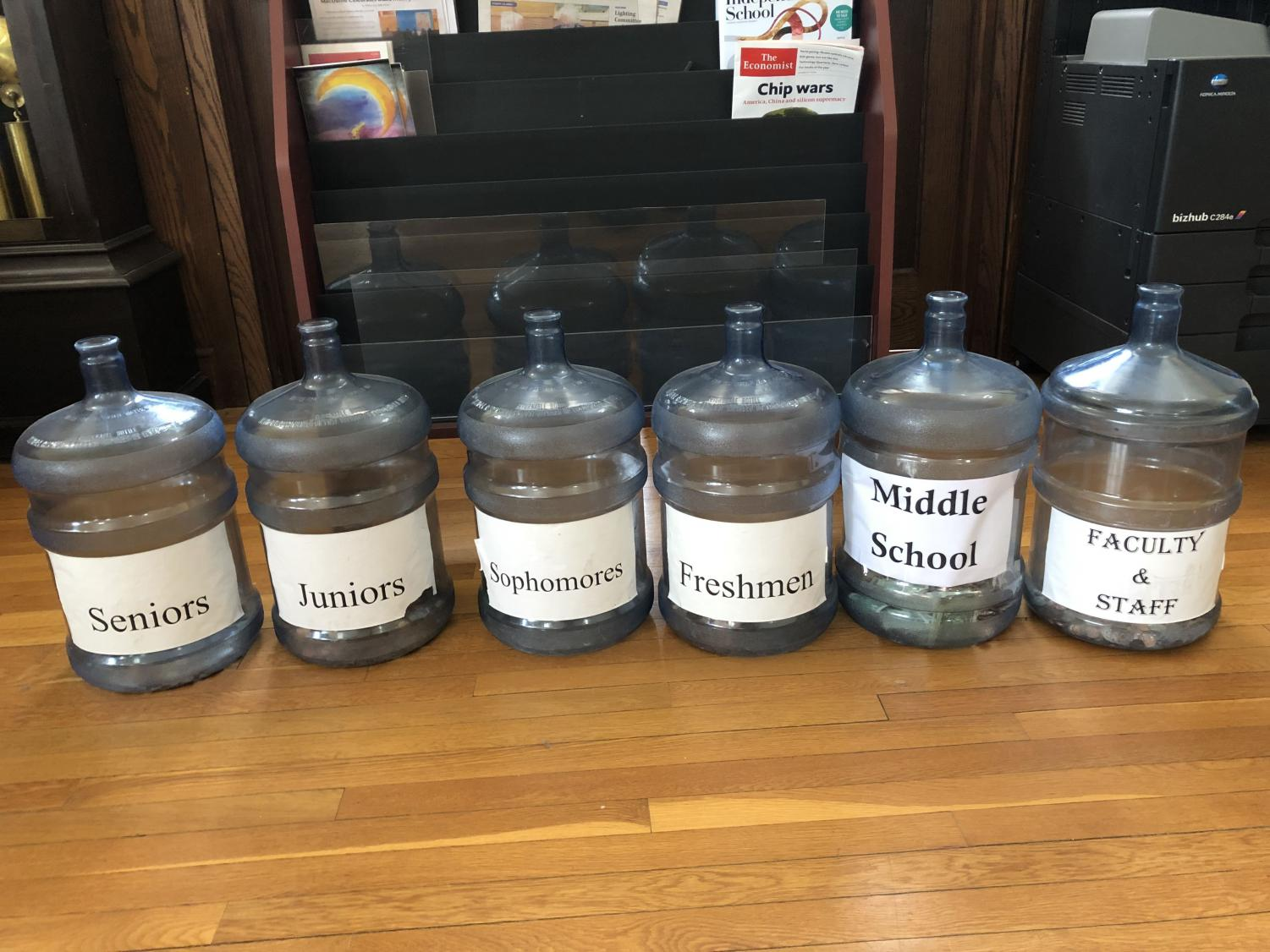The jars holding money donated from each grade. Students can place their change in these jars to participate in the fundraiser. Photo by Mohammed Abbasi