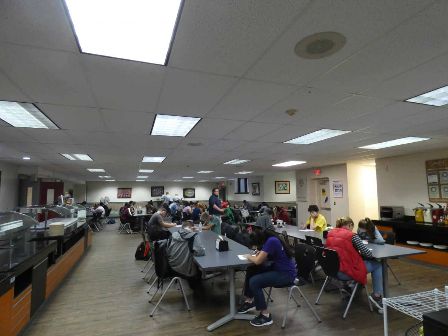 Students answer problems during the WMML meet held in the MacDuffie cafeteria in the fall.