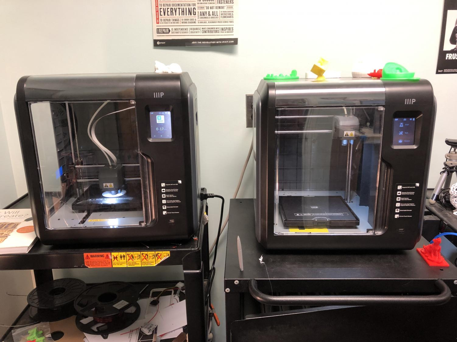 The two Monoprice MP Voxel printers in the IT Department. The left printer is in the process of printing an item. Photo courtesy of Mohammad Abbasi.