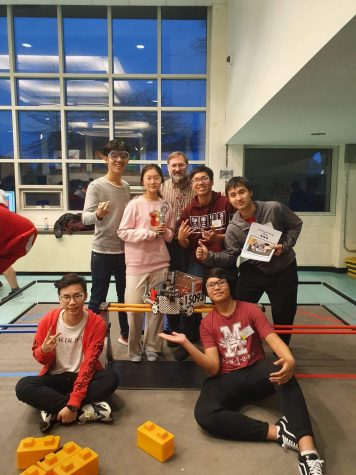 The MacDuffie Robotics Team with their robot at the FIRST Tech Competition in January.