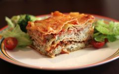 Lasagna with salad. <i>Photo by Flickr from https://commons.wikimedia.org/w/index.php?curid=18808925<i/>