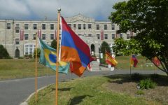 Flags from the countries of MacDuffie's students fly in front of the school at graduation in 2020. This tradition is meant to reflect and honor the large international population at the school.